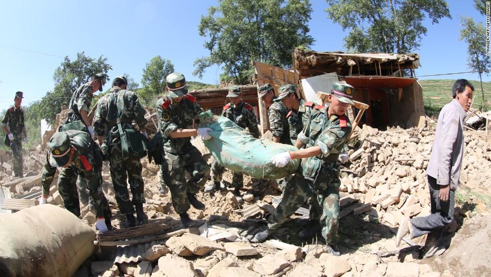 Rescuers clean up debris at Lalu village in Minxian on July 22.