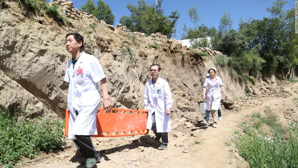 Rescuers arrive at Lalu village in Minxian on July 22.