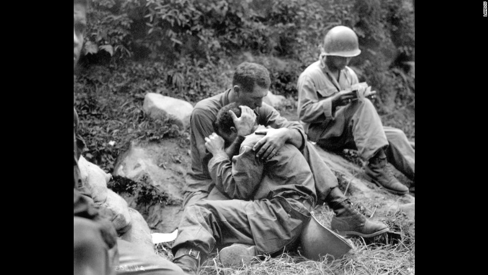 An American soldier comforts a comrade during the Korean War, circa 1950. Click through to see more scenes from the Korean War.