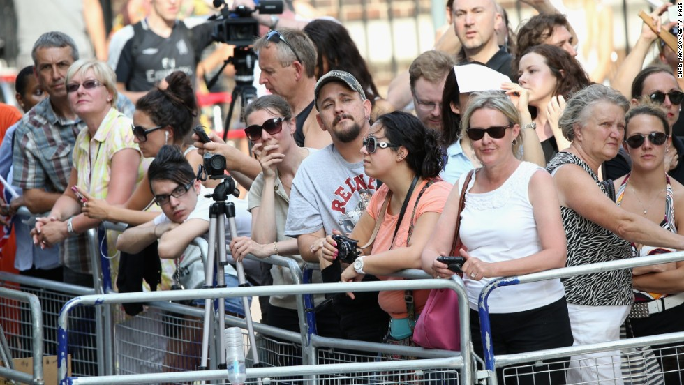 Crowds gather behind a barricade outside St. Mary's Hospital as they wait for news of the birth on July 22.