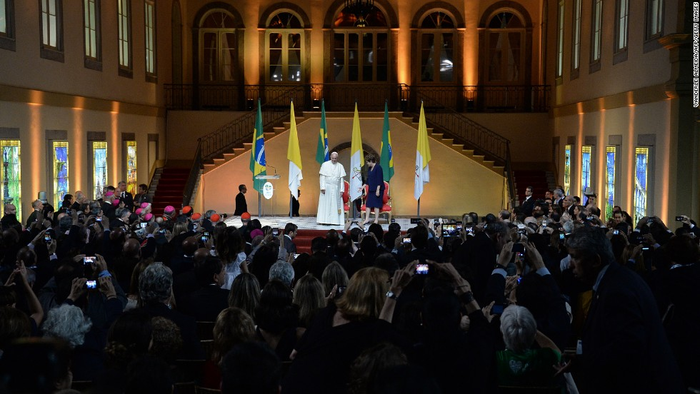 Pope Francis takes the stage with President Dilma Rousseff at the Guanabara Palace on July 22.