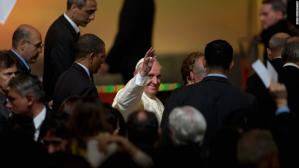 Pope Francis waves to the crowd at the Guanabara Palace on July 22.