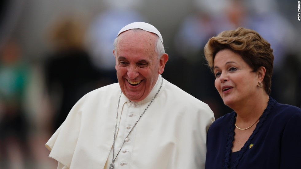President Dilma Rousseff accompanies Pope Francis after his arrival at the international airport in Rio de Janeiro on July 22.