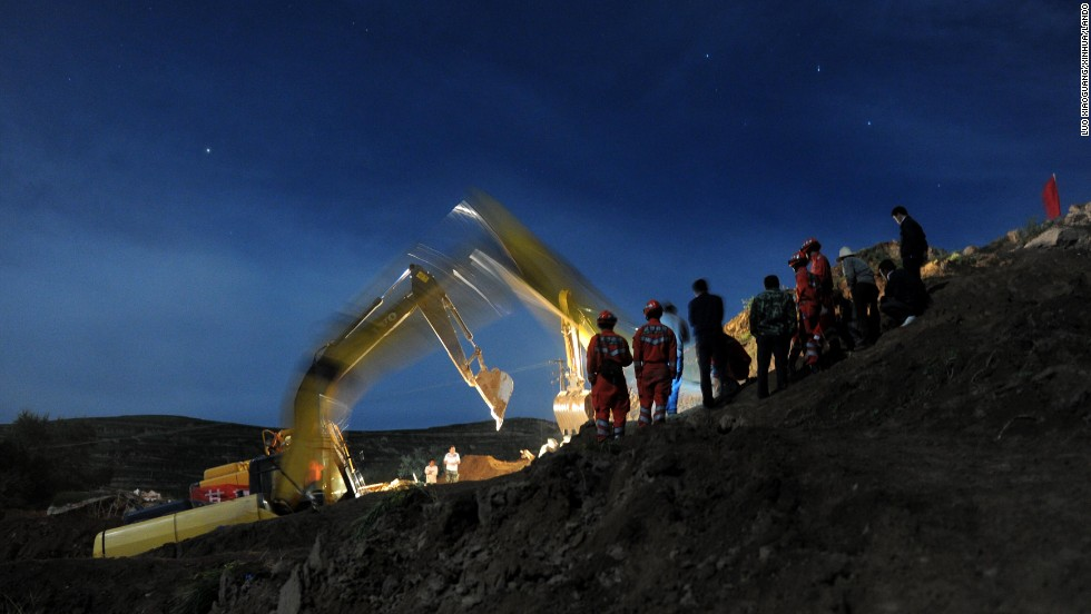 Rescuers work to clear rubble in Yongguang on July 23.