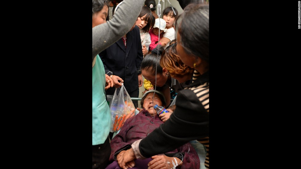 An injured woman receives treatment at a hospital in Minxian County, northwest Gansu Province, on July 22.