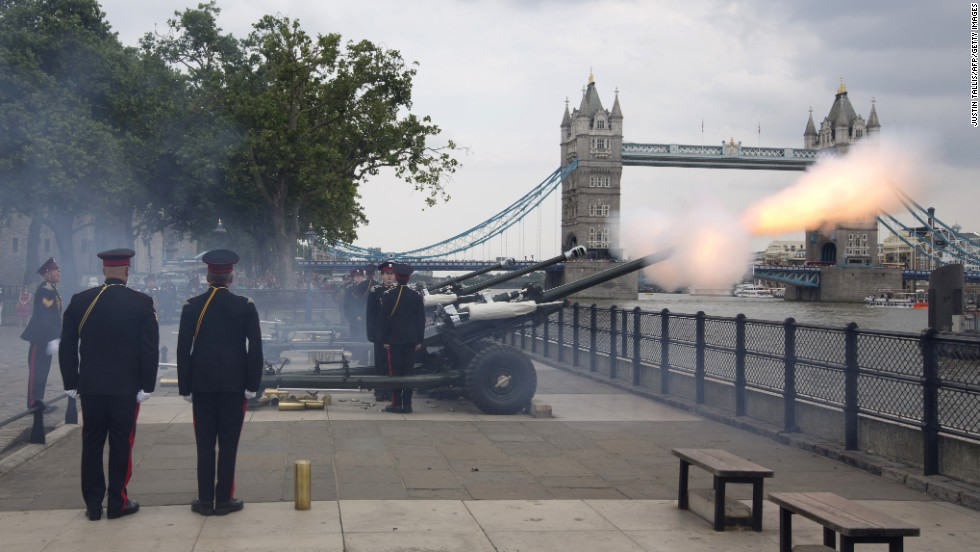Members of the Honourable Artillery Company fire a salute  at the Tower of London on Tuesday, July 23, to mark the birth of a son to Prince William and Catherine, Duchess of Cambridge.