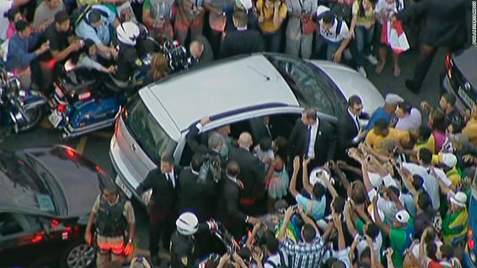 Pope Francis' car is surrounded by well-wishers after the driver took a wrong turn along the route from the Rio de Janeiro airport to the Metropolitan Cathedral on July 22 in this still image taken from video.