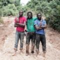 invisible borders Emeka, Jide and Emmanuel in the mud, Ekok Road, Cameroun