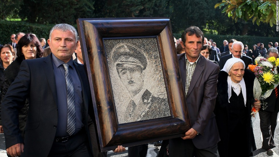 After being booted out of Albania in 1939, the dictatorial King Zog's unlikely residence was Parmoor House, in Buckinghamshire -- it's currently a religious retreat. Here, supporters of the self-titled Zog carry his portrait at a reburial ceremony in Tirana.