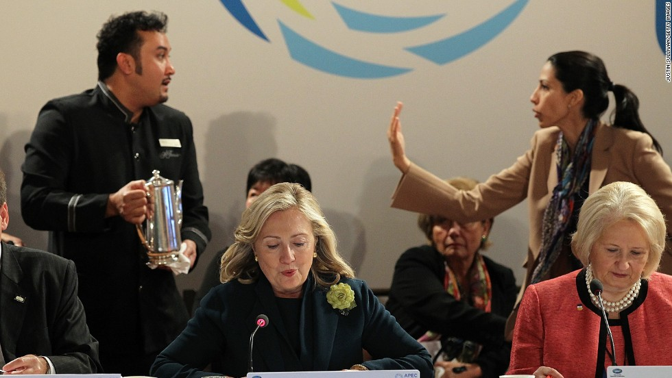 Abedin asks a coffee server to move out of the way as Clinton speaks during a roundtable discussion at the APEC Women and the Economy Summit on September 16, 2011, in San Francisco.