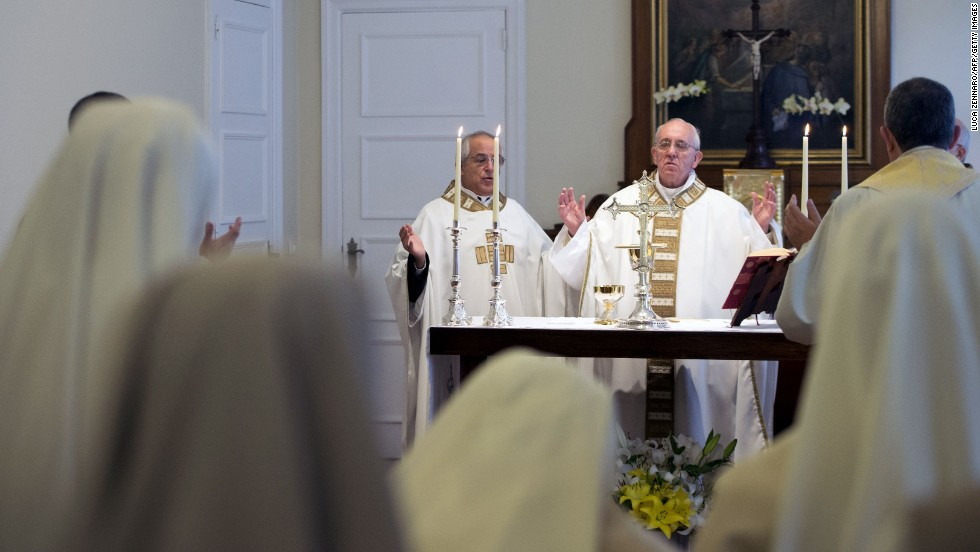 Pope Francis celebrates Mass at a chapel inside the Sumare residence, where he is staying in Rio de Janeiro, on Tuesday, July 23. Pope Francis took a break from his schedule in Brazil on Tuesday as authorities assessed security lapses during a raucous welcome ceremony by tens of thousands of adoring pilgrims.