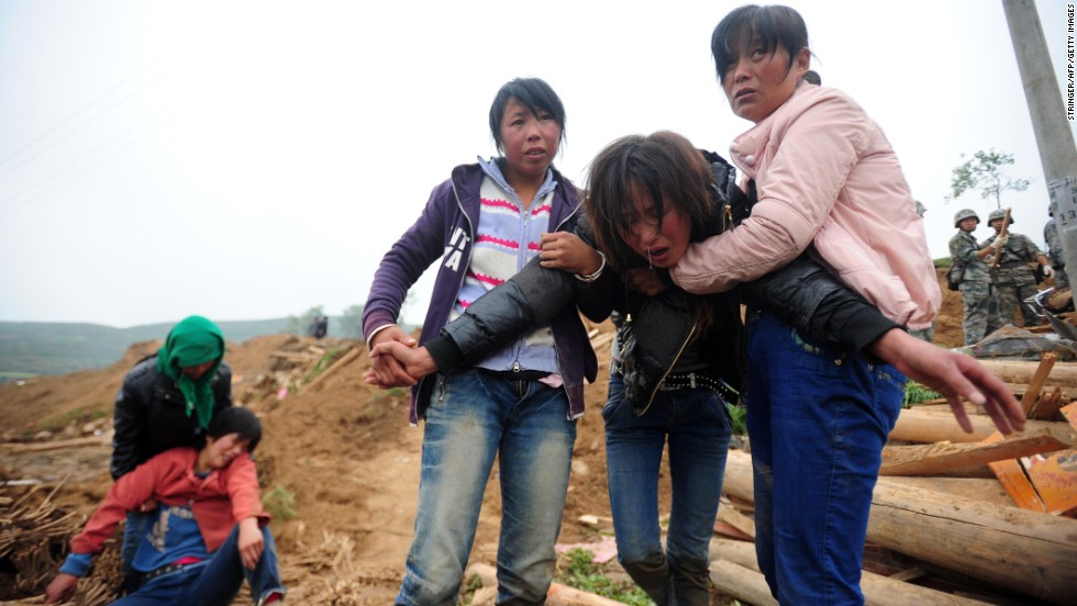 Villagers grieve in Yongguang, China, on July 23.