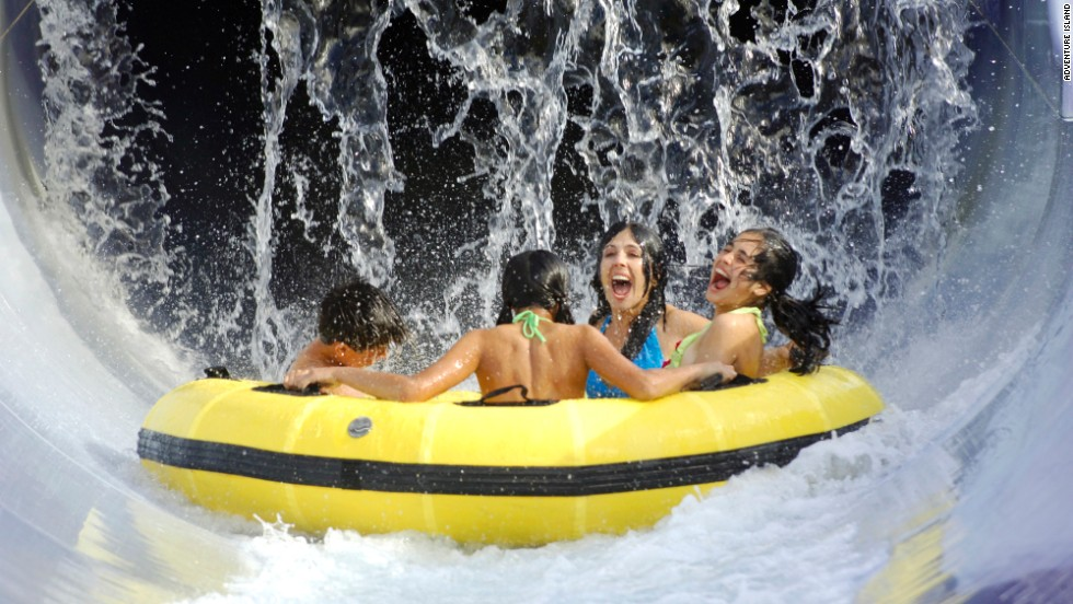 Riding Wahoo Run at Adventure Island in Tampa, Florida, provides soaking wet thrills. Rafts carrying as many as five people shoot through a water flume at speeds exceeding 20 feet per second. They corkscrew through a half-enclosed tunnel into a splash pool. More than 650,000 people passed through Adventure Island's gates last year, according to the Themed Entertainment Association.