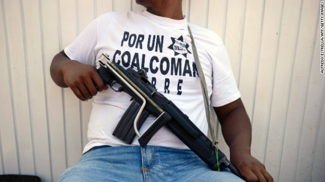 (File photo) An armed member of 'community police' keeps watch in Michoacan State, Mexico, on May 22, 2013.