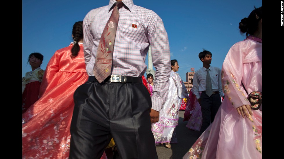 Men and women dance in front of the Monument to the Party Founding in Pyongyang on Wednesday, June 19. The performance celebrates the day the late North Korean leader Kim Jung Il began his work at the central committee of the communist nation's ruling Workers' Party in 1964.