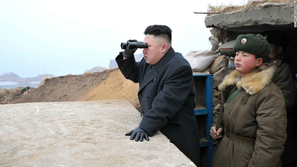 North Korean leader Kim Jong Un uses a pair of binoculars to look south from the Jangjae Islet Defense Detachment near South Korea's Taeyonphyong Island on Thursday, March 7. Kim is the youngest son of Kim Jong Il and came into power after his fathers death in 2011.