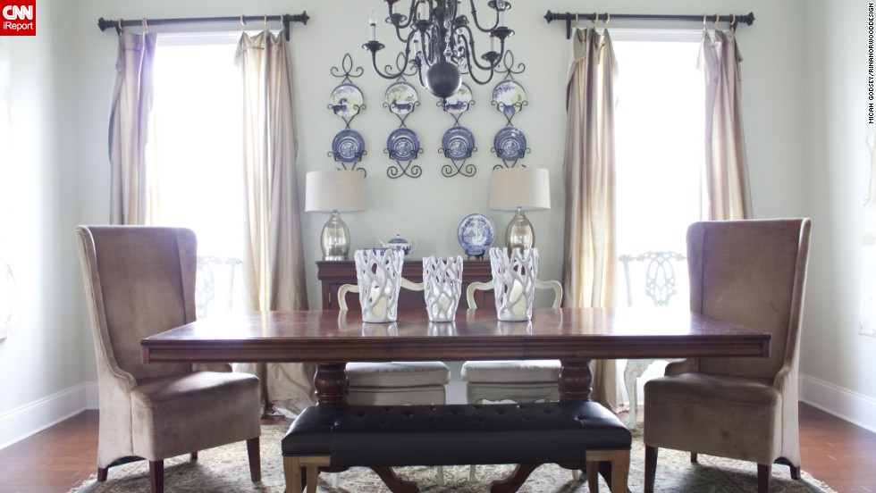 "<a href=""http://ireport.cnn.com/docs/DOC-1007371"">Norwood's</a> kitchen opens up to a large eating area, which she kept semiformal and comfortable with an eclectic collection of chairs."