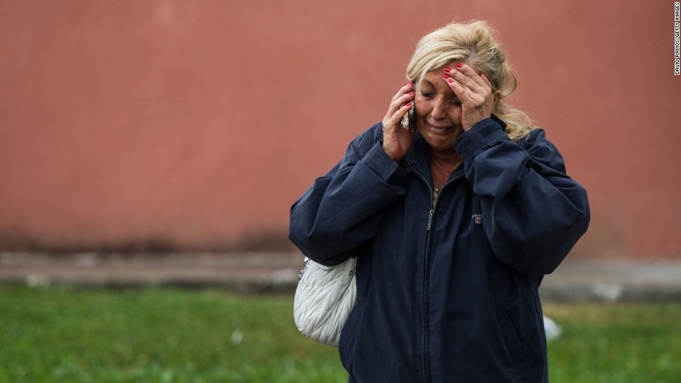 A relative of one of the passengers waits to hear news in Santiago de Compostela on July 25.