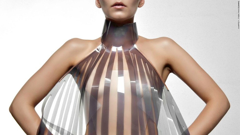 Dutch design collective Studio Roosegaarde have developed a sensual dress called Intimacy 2.0 together with designer Anouk Wipprecht. Made of leather and smart e-foils, it 'explores the relationship between technology and intimacy'. The high-tech panels are stimulated by the heartbeat of the wearer. Initially opaque or white, they become increasingly transparent when exposed to an electric current -- in this case a beating heart.