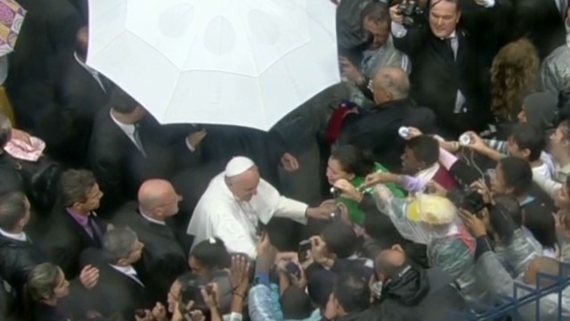 Pope walks among followers in Brazil