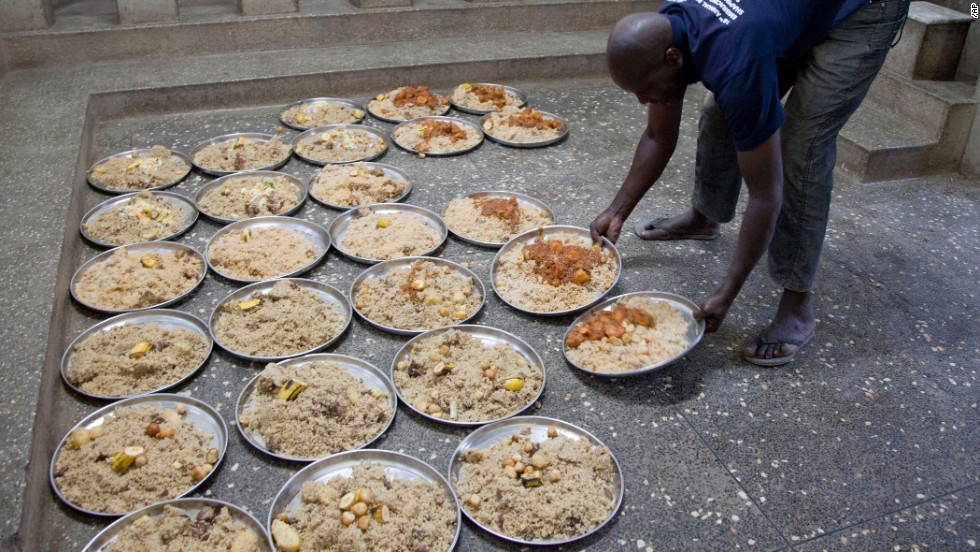 A mosque worker prepares meals for the poor and those coming to break their fast at the mosque on July 25 in Nairobi, Kenya.