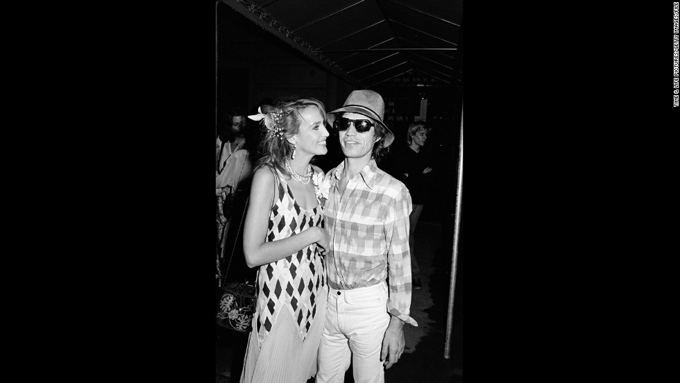 In his private life, Jagger also favors slacks that cut a sharp figure. Here, Jagger poses with his now-ex Jerry Hall around 1981.