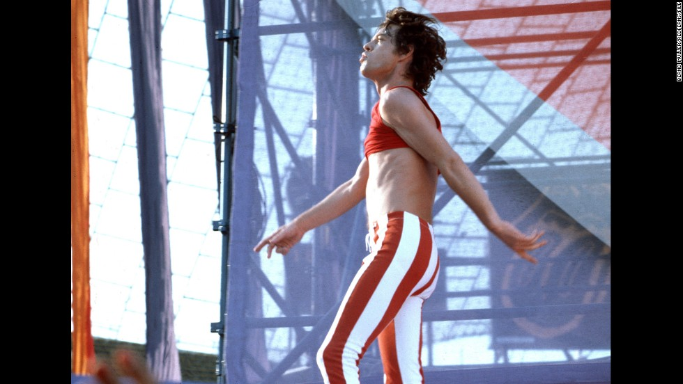 """In 2011, Maroon 5's Adam Levine paid homage to Jagger's vintage look -- such as this midriff-baring outfit from the Rolling Stones' 1982 European tour -- in the music video for """"Moves Like Jagger."""" In it, Levine, too, slips into a pair of skintight skinnies and rocks out without a shirt."""