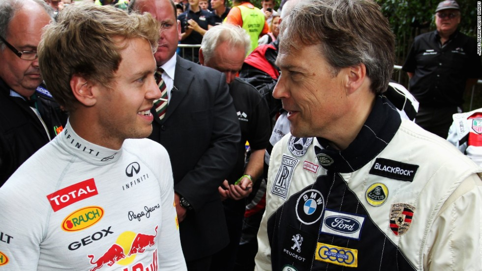 Lord March, who runs Goodwood, meets F1 world champion Sebastian Vettel at the Festival of Speed in 2012. The event has become a favorite on the social season calendar.