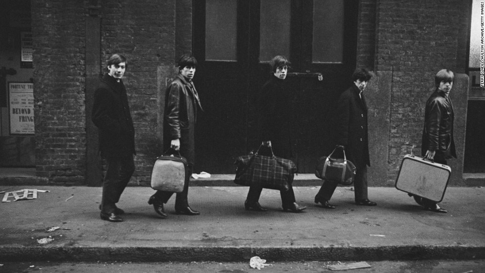 From left, Charlie Watts, Keith Richards, Mick Jagger, Bill Wyman and Brian Jones carry their bags past London's Donmar Rehearsal Theatre in 1963.