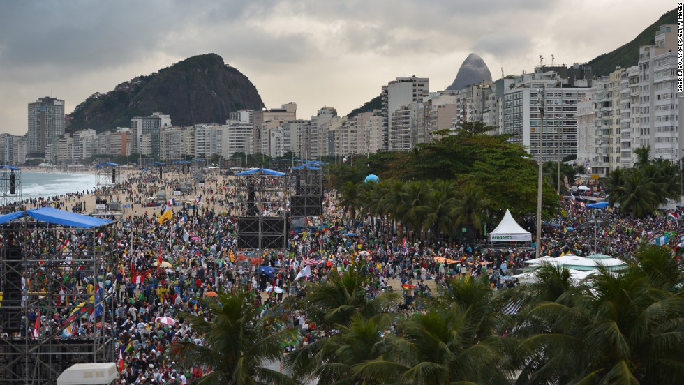 Thousands of young people gather at Rio de Janeiro's iconic Copacabana beach on July 25 to welcome the pope.