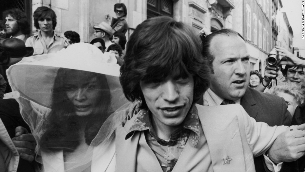 Mick Jagger and his new bride, Bianca Perez Morena de Macias, make their way through the crowds on their wedding day in 1971 in St. Tropez, France.