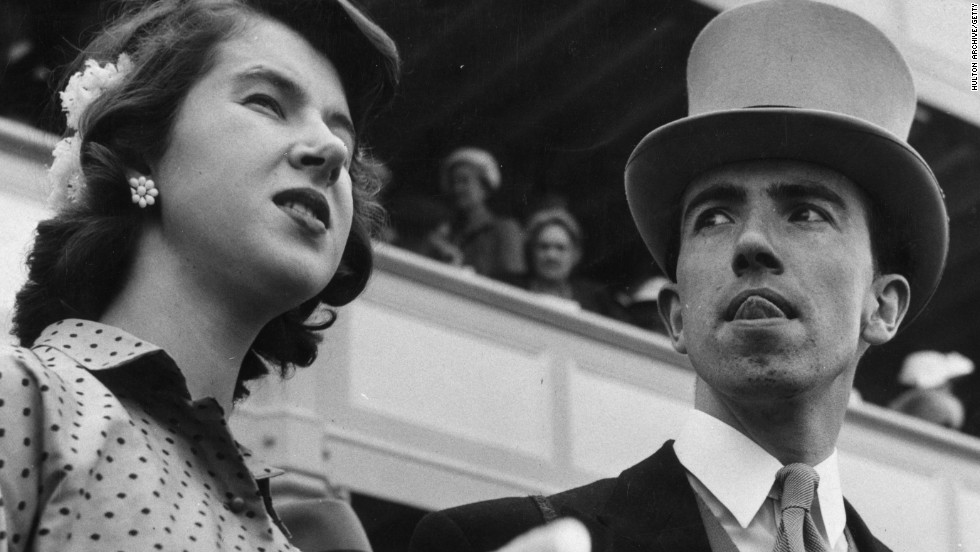 A young debutante and gentlemen friend attend Royal Ascot in 1953.
