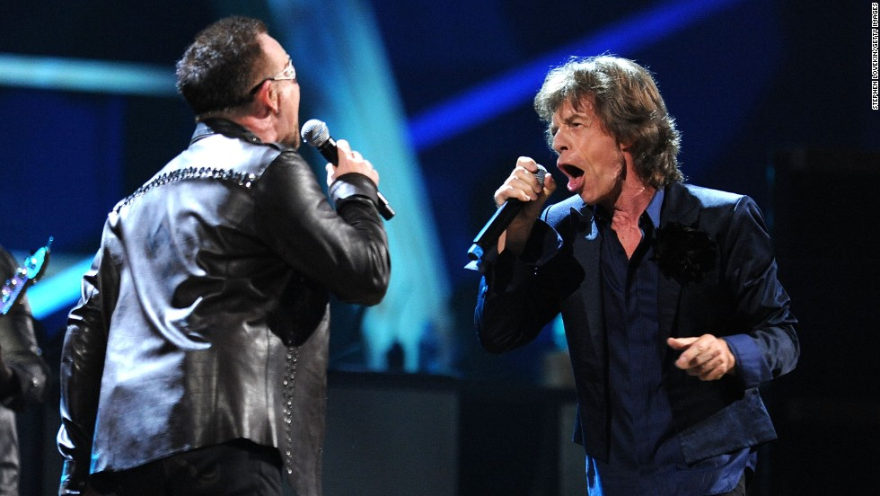 Bono of U2 and Mick Jagger perform together at a concert at Madison Square Garden in New York marking the 25th anniversary of the Rock and Roll Hall of Fame on October 30, 2009.