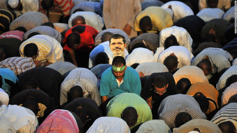 Morsy supporters say evening prayers during a rally July 25 outside a Cairo mosque.