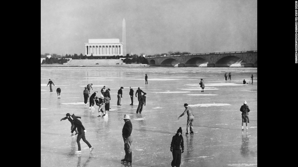 People skate on the frozen Potomac River in front of the memorial in this undated photo.