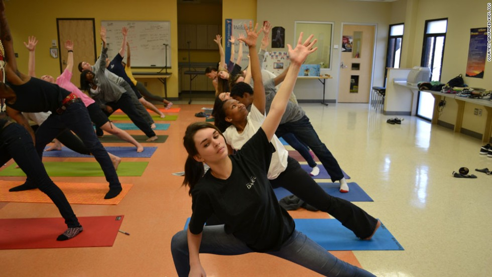 With the extended side angle pose, students at Decatur High School in Decatur, Georgia, strengthen their thighs, hips, knees and ankles.