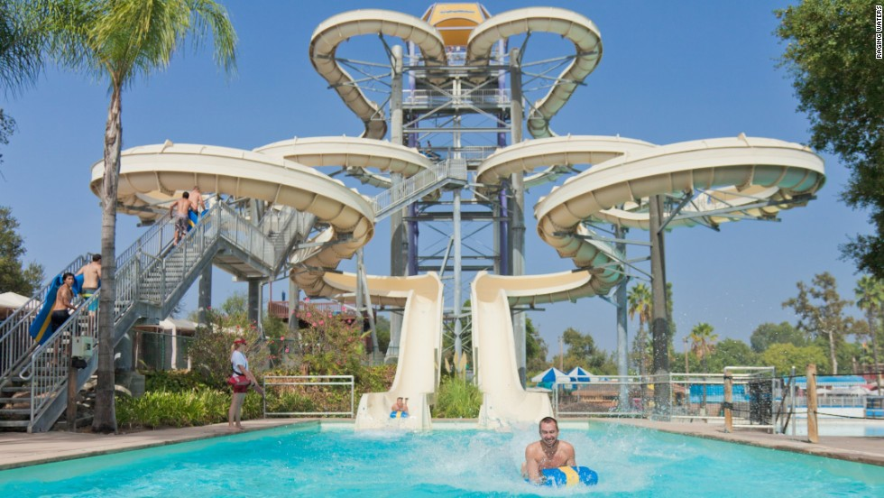 "Raging Waters in San Dimas bills itself as California's largest water park. Its signature attraction is High Extreme -- which rises ten stories and drops riders about 600 feet down a flume. The Speed Slides ride pumps 2,000 gallons of water per minute down a chute eight stories high. ""At that rate it's like filling a bathtub in 1 second,"" says marketing director Mary Papadopoulos. Some 480,000 visitors experienced Raging Waters last year. For Papadopoulos the surrounding landscape makes the park unique. ""It's just an absolutely beautiful setting,"" she says. ""You've got the mountains around you."""