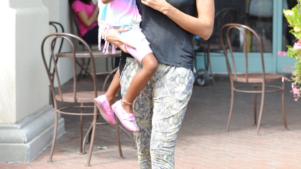Heidi Klum carries one of her daughters while on a Jamba Juice run on July 25.