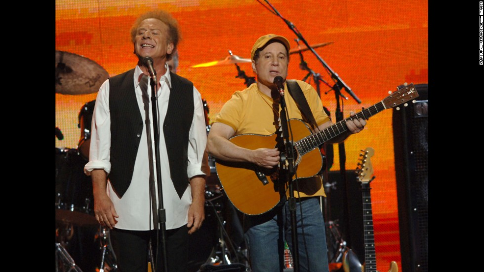 "Art Garfunkel and Paul Simon perform during ""From the Big Apple to the Big Easy,"" a benefit concert for Hurricane Katrina relief, in September 2005."