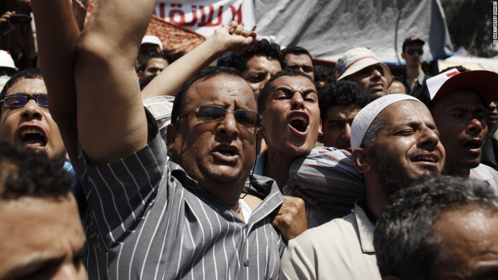 Supporters of Morsy protest outside a field hospital in Cairo where the bodies of slain Morsy supporters have been brought July 27.