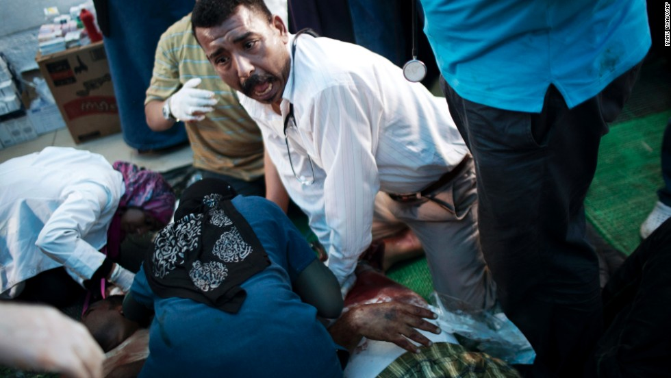 Doctors treat an injured supporter of deposed Egyptian President Mohamed Morsy during clashes with security forces in Cairo on Saturday, July 27.