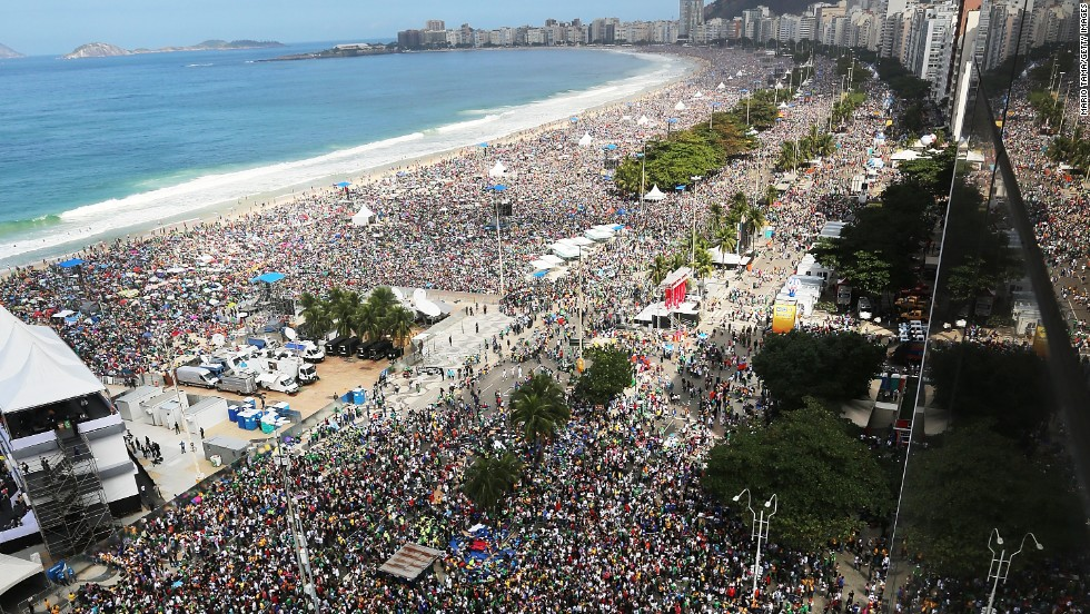 Faithful as far as the eye can see crowd Copacabana Beach on July 28, during Pope Francis' final Mass of his visit to Brazil. The stage from where the pope was speaking is seen on the lower left.