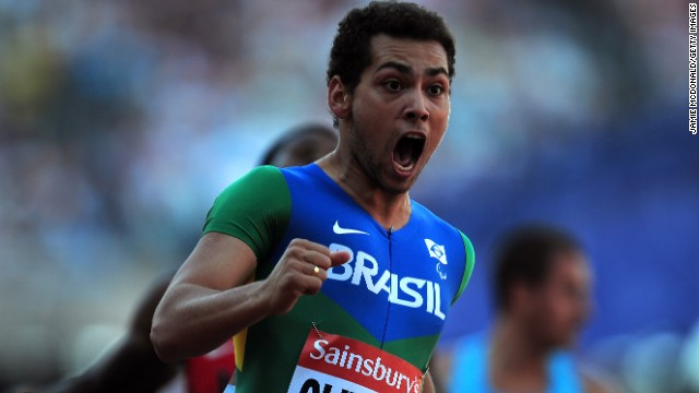 Alan Oliveira shows his delight after smashing his own 100m world record for double amputee sprinters.