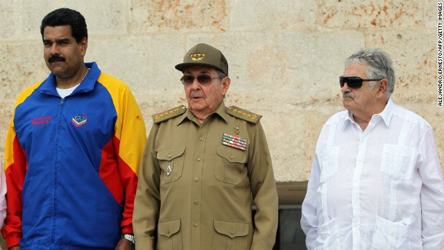 Cuban President Raul Castro (C), and his counterparts from Venezuela, Nicolas Maduro (L), and Uruguay, Jose Mujica, attend a ceremony  in Santiago de Cuba on Friday.