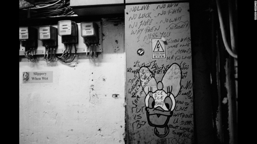 Multilingual graffiti is common in Chungking Mansions. Along with drawings of Disney characters, vandals often leave poems or messages for friends and lovers.