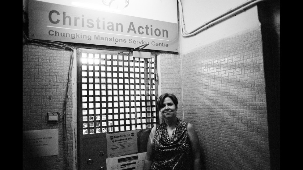 "On the top floor of Chungking Mansions, the Christian Action Service Centre provides food, education and pro-bono counseling to nearly 500 refugees and asylum seekers each month. Manager Julee Allen (pictured) says refugees often arrive in Hong Kong with ""extensive needs."""
