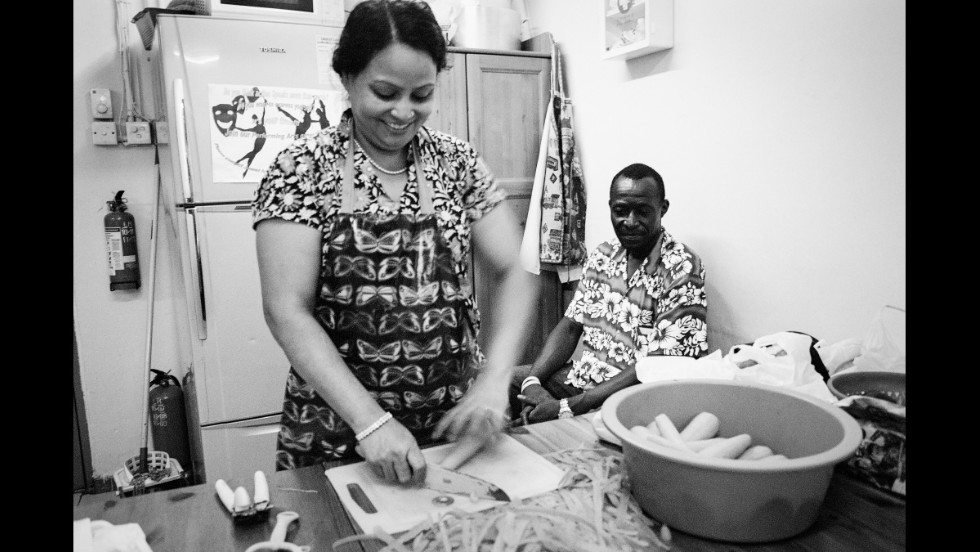 "Preparing a Ramadan meal for refugees in the Christian Action Service Centre. About 50 to 100 refugees visit the center daily. ""Sometimes they have problems with their housing,"" says manager Julee Allen ""Other times they have unaddressed medical needs. And sometimes they'll just drop in to say hi."""
