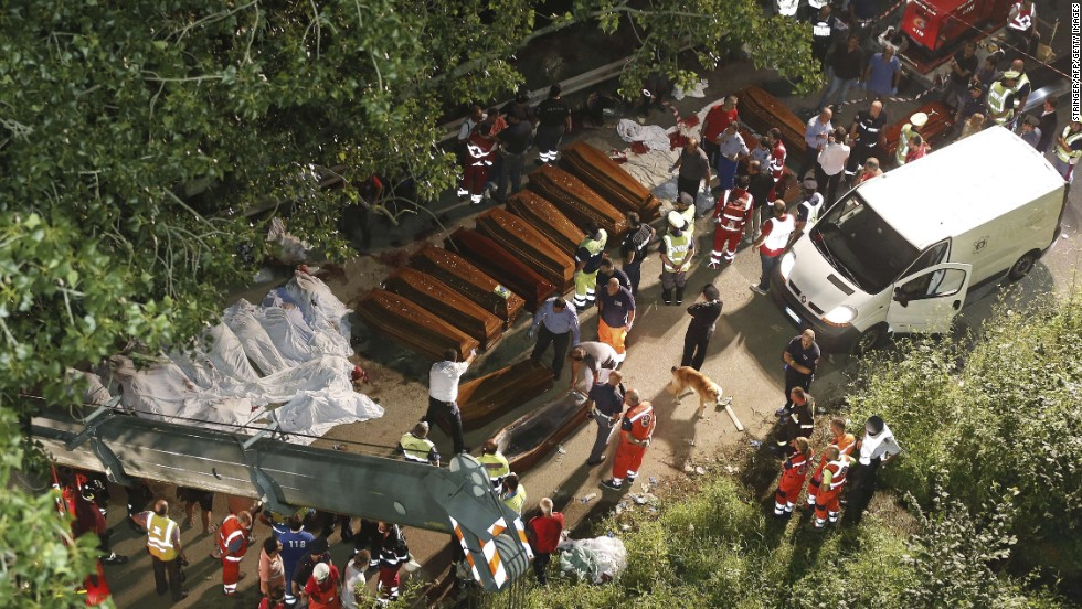 Rescuers prepare coffins for victims of the crash on Sunday, July 28.