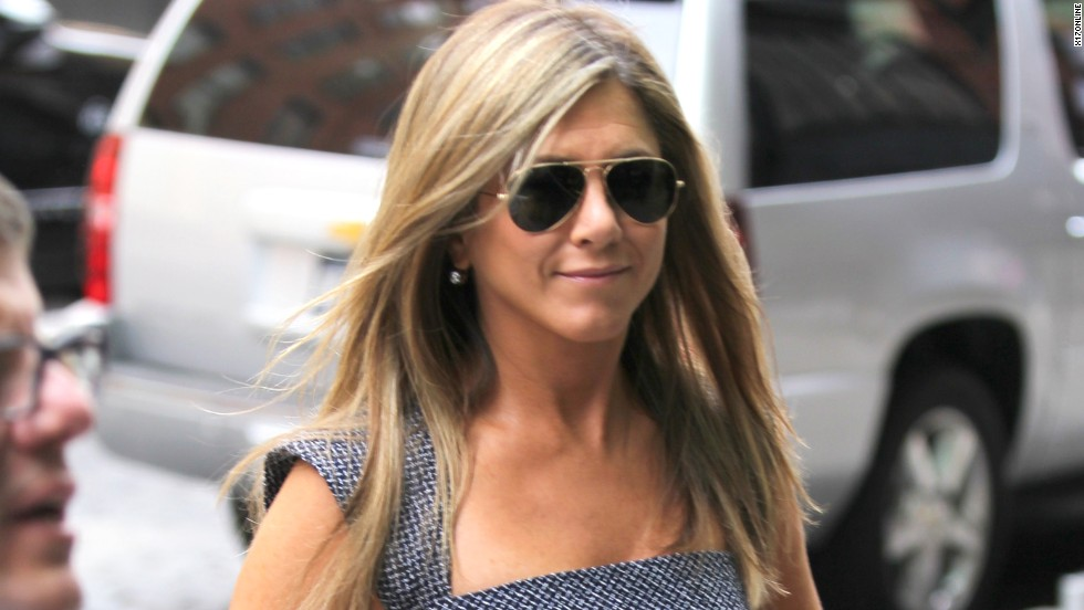 Jennifer Aniston rocks a flirty dress while arriving at New York's Crosby Hotel on July 27.