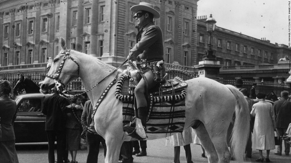 The Lone Ranger character spawned novels, comic books, a TV series and films around the world. Here Moore visits London's Buckingham Palace in costume as part of an appearance on BBC radio and TV in 1958.